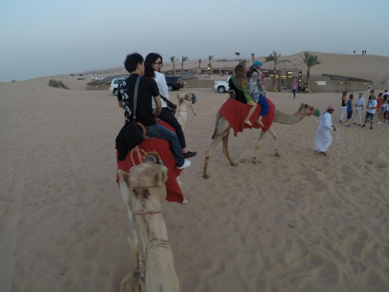 Riding a camel Dubai desert
