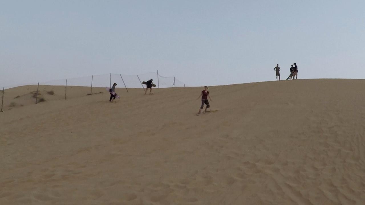 Sandboarding Dubai desert